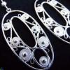 Bijoux en argent aux formes rondes et douces, discrètes et féminines